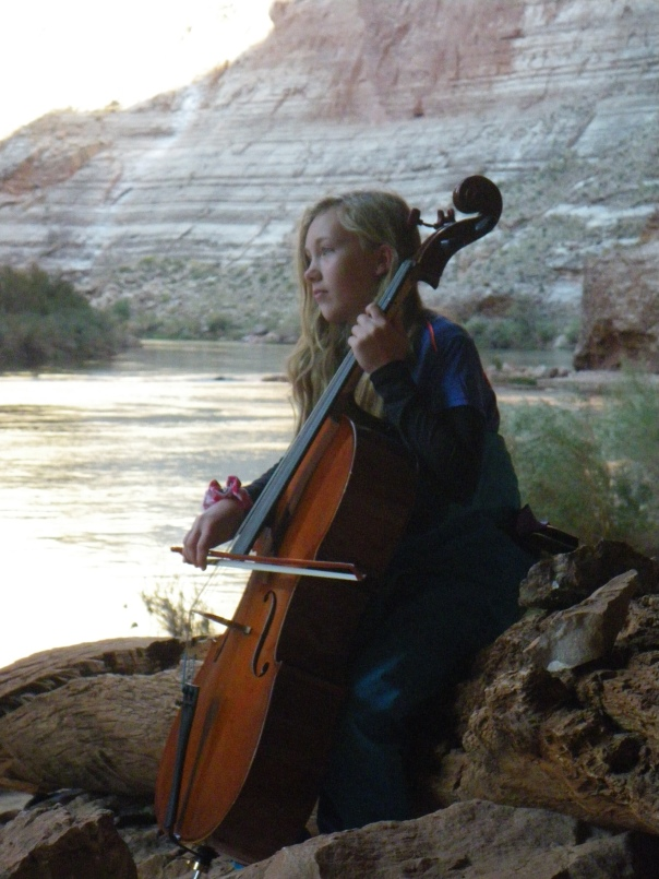 Ariel plays cello at Redwall Cavern, Grand Canyon