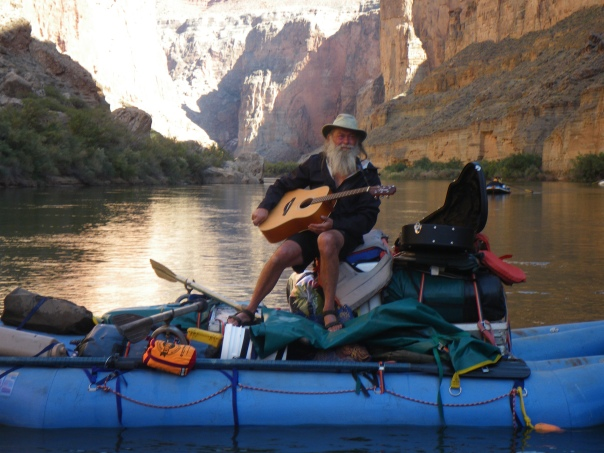 Playing guitar on the river